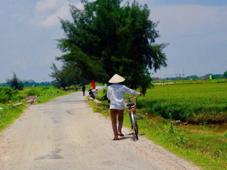 Man with bike Thuy Thanh Village Hue Vietnam