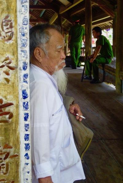 Old man Japanese Bridge Thuy Thanh Village Hue Vietnam