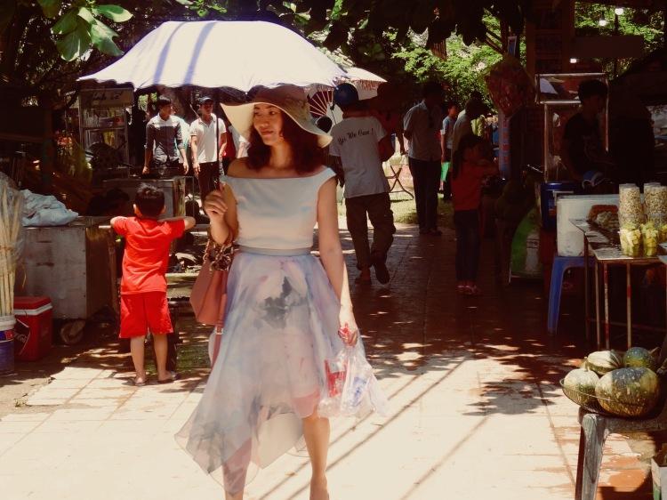 Woman holding umbrella Thuy Thanh Village Hue