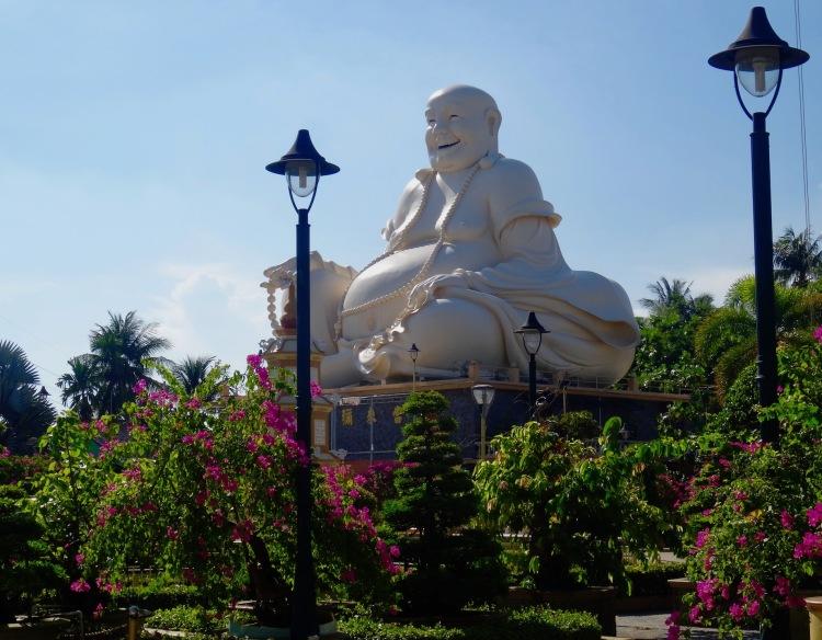 Laughing buddha Vinh Trang Pagoda The Mekong Delta