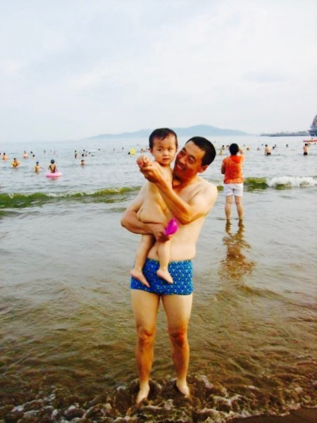 Father and son Number 1 Bathing Beach Qingdao Shandong Province China