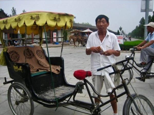 Rickshaw driver Qufu Shandong Province China