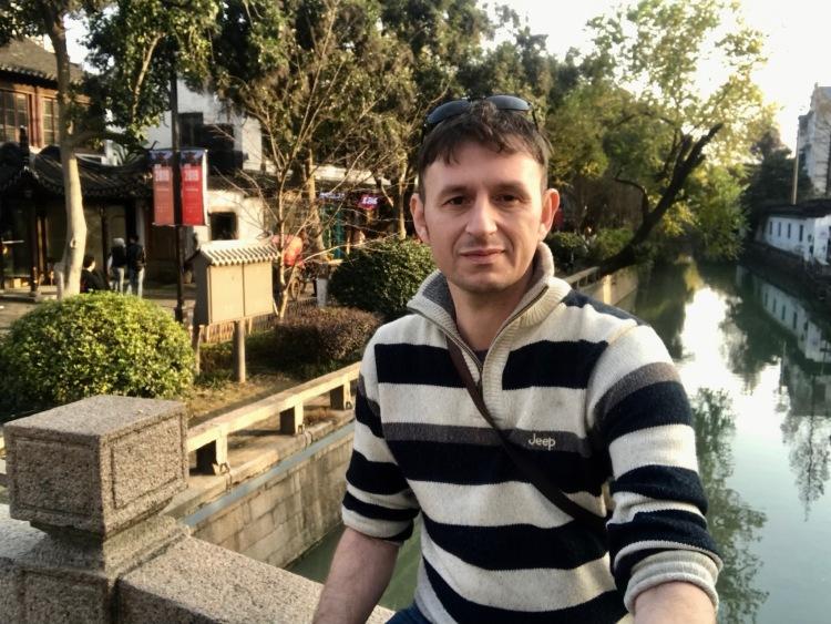 Sitting on Hu Xiang Shi Bridge Suzhou Jiangsu Province China