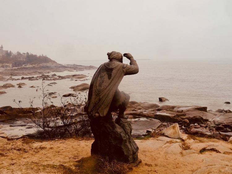 Man looking out to sea Chongwu Stone Arts Expo Park Beach Fujian Province