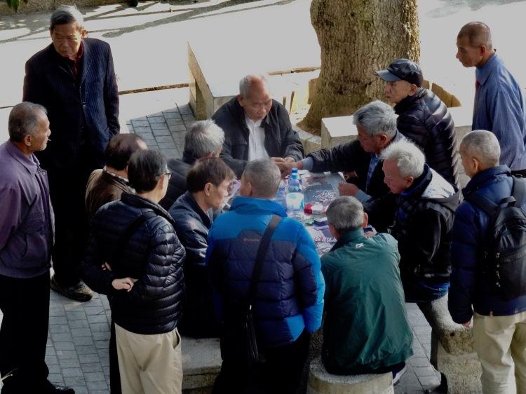 Old men playing Mahjong Camoes Garden Macau