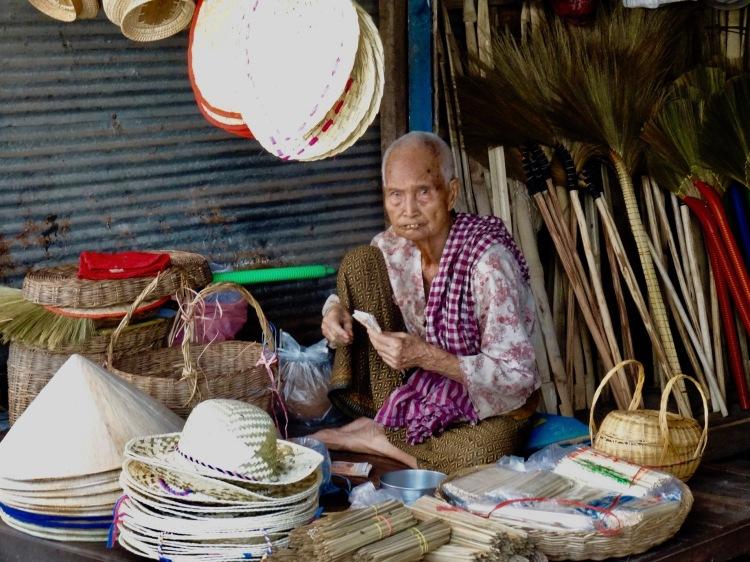 Old woman Psar Leu Market Siem Reap Cambodia