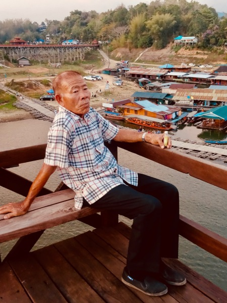 Sittin doin nothin Saphan Mon Bridge Sangkhlaburi Thailand