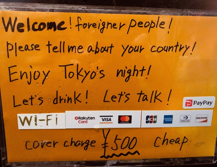 Foreigners welcome sign Golden Gai Bar District Tokyo.