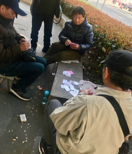 Men playing cards Shanghai French Concession.