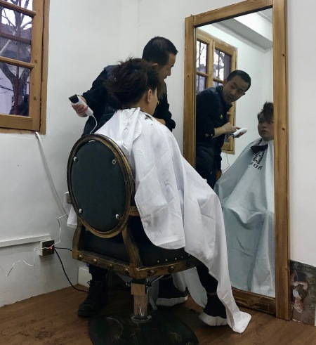 Old style barber Shanghai French Concession.