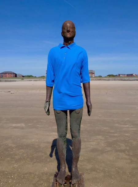 Antony Gormley Statue in the sand Crosby Beach Liverpool.