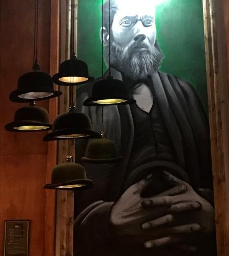 George Williams painting Hatters Hostel Liverpool.