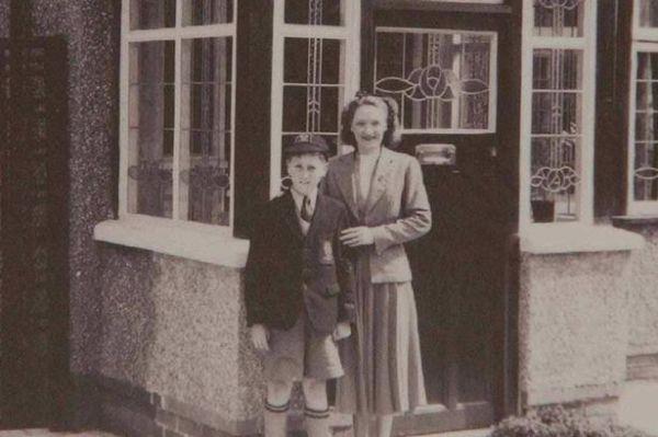 John Lennon outside Mendips with his aunt Mimi.