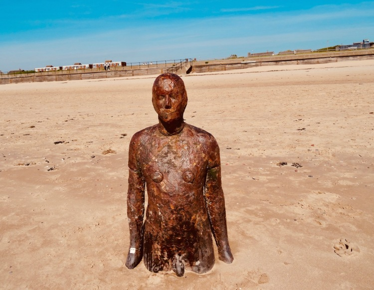 One of Antony Gormley's Statues in the Sand Crosby Beach Liverpool.