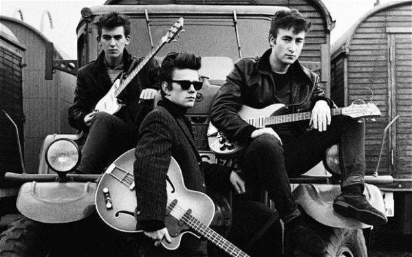 Stuart Sutcliffe with George Harrison and John Lennon.