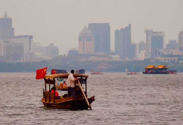 Boat cruise West Lake Hangzhou China.